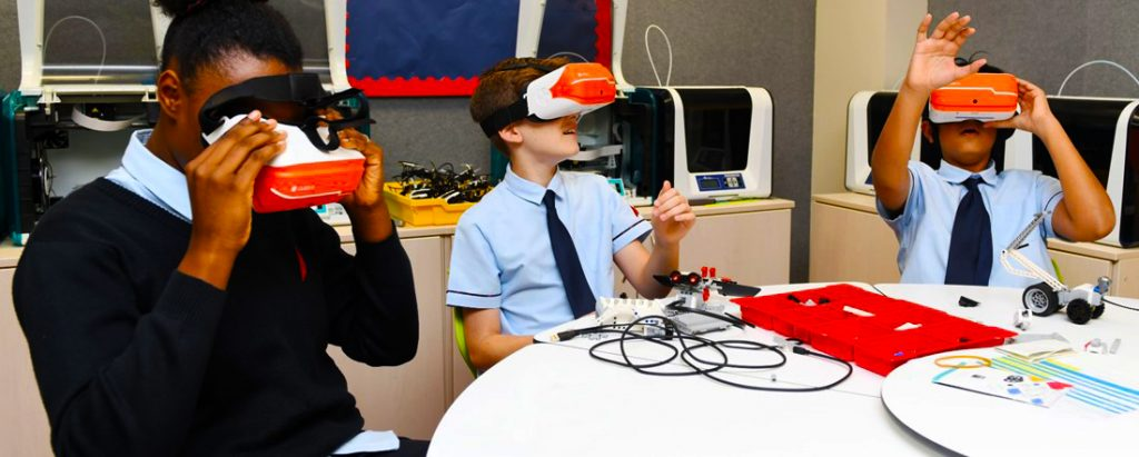 Children at GEMS Dubai American Academy engaging in learning with Virtual Reality headsets