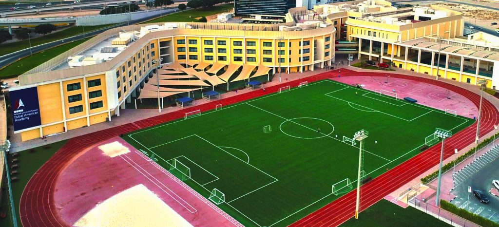 An aerial view of Dubai American Academy showcasing the school's outstanding sporting pitch and facilities