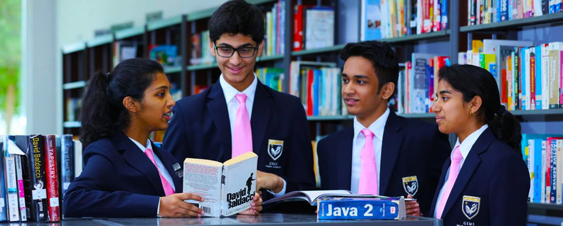 Photograph of older students at GEMS Modern Academy in Dubai highlighting the specialist International Baccalaureate Diploma option available to gifted children