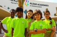 Photograph of children outside Al Mamoura Academy buildings in Abu Dhabi