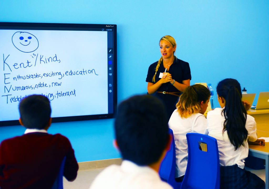 Image showing teacher exploring the values at the heart of school life in Kent College Dubai
