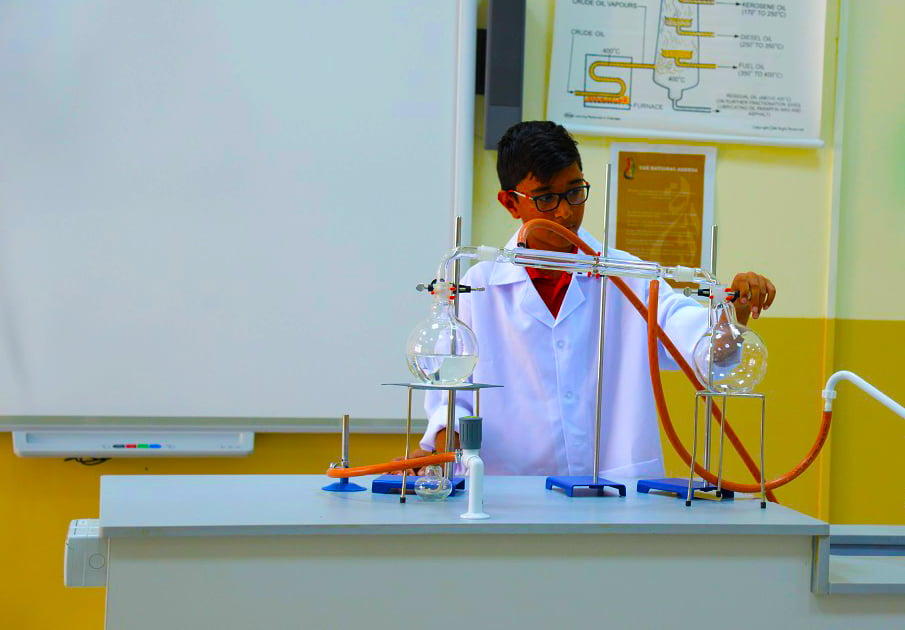 Image of a student exploring precipitation in the Chemistry Lab at Springdales School in Dubai