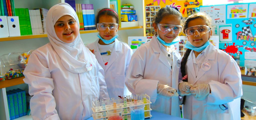 An image of young female students undertaking Lab work in Chemistry at the School of Research Science in Dubai