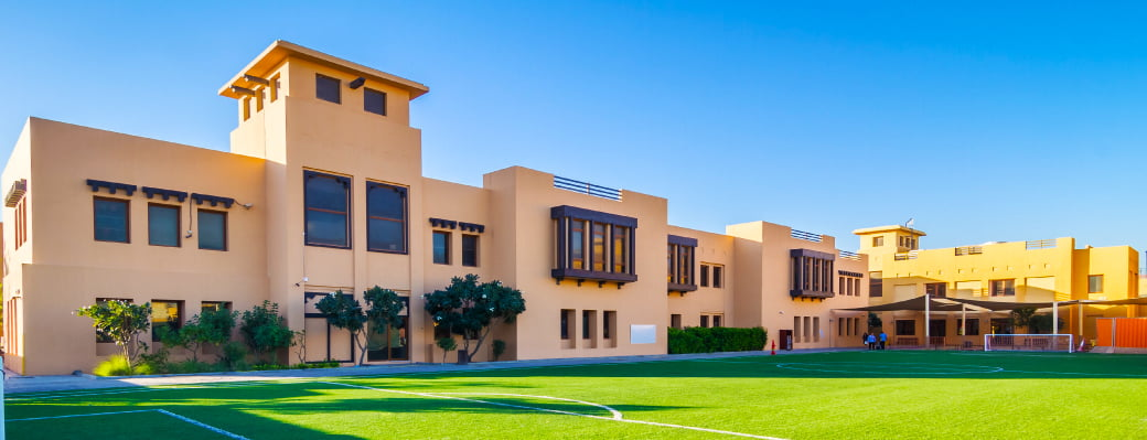 Photo of the Main School Building and playing fields of Raha International School in Abu Dhabi