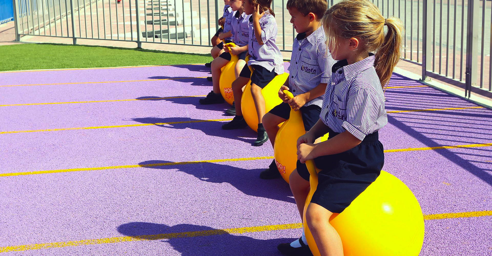 Young children have a race on air hoppers at Safa Community School in Dubai