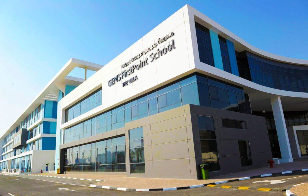 Photograph showing the exterior entrance of GEMS FirstPoint School in Dubai. GEMS FirstPoint school is a British all-through offering a high value Tier 1 education to students from Primary through to GCSE, A Level and BTEC.