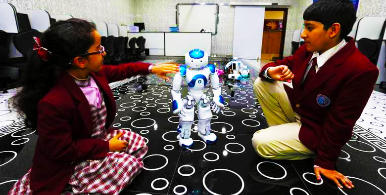 Image showing children learning with a robot at Merryland International School in Abu Dhabi