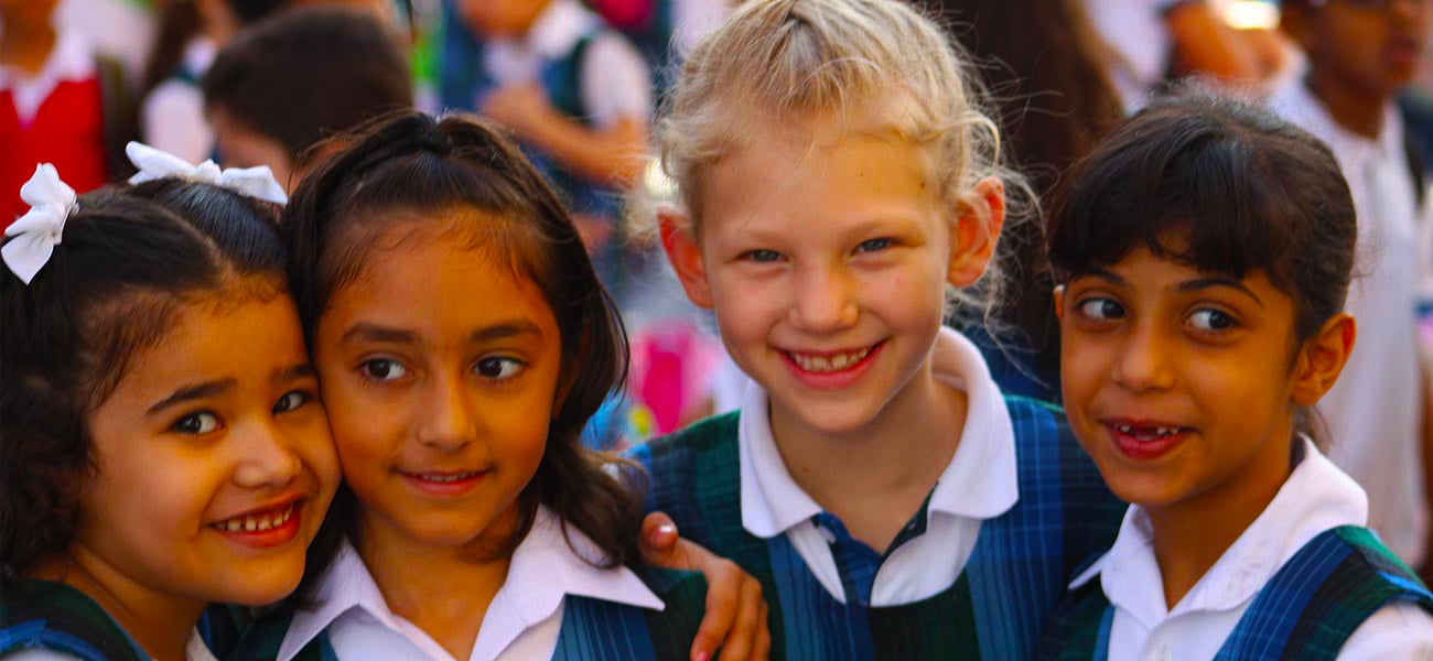 Photograph of children at Reach British School in Abu Dhabi in their school uniforms