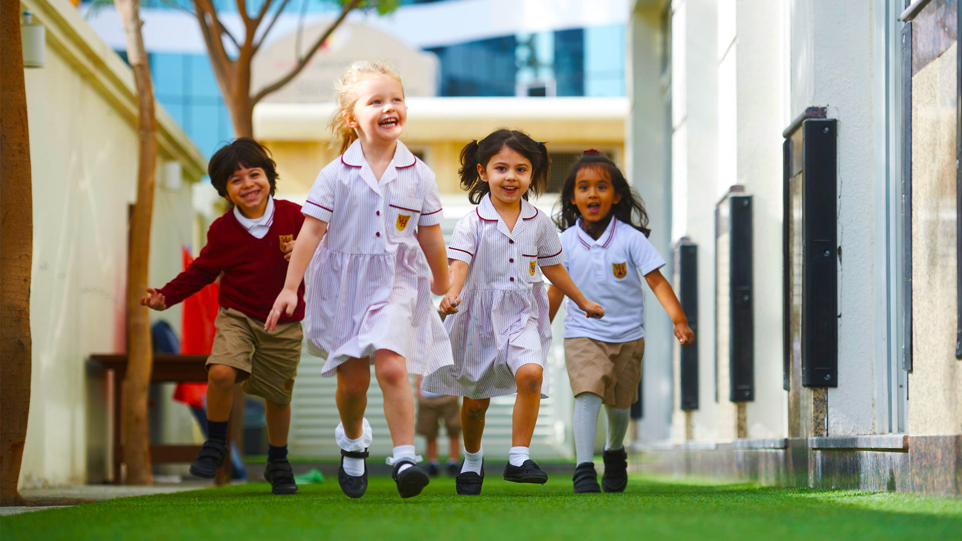 Image of children at Victory Heights primary School VHP in Dubai running and happy