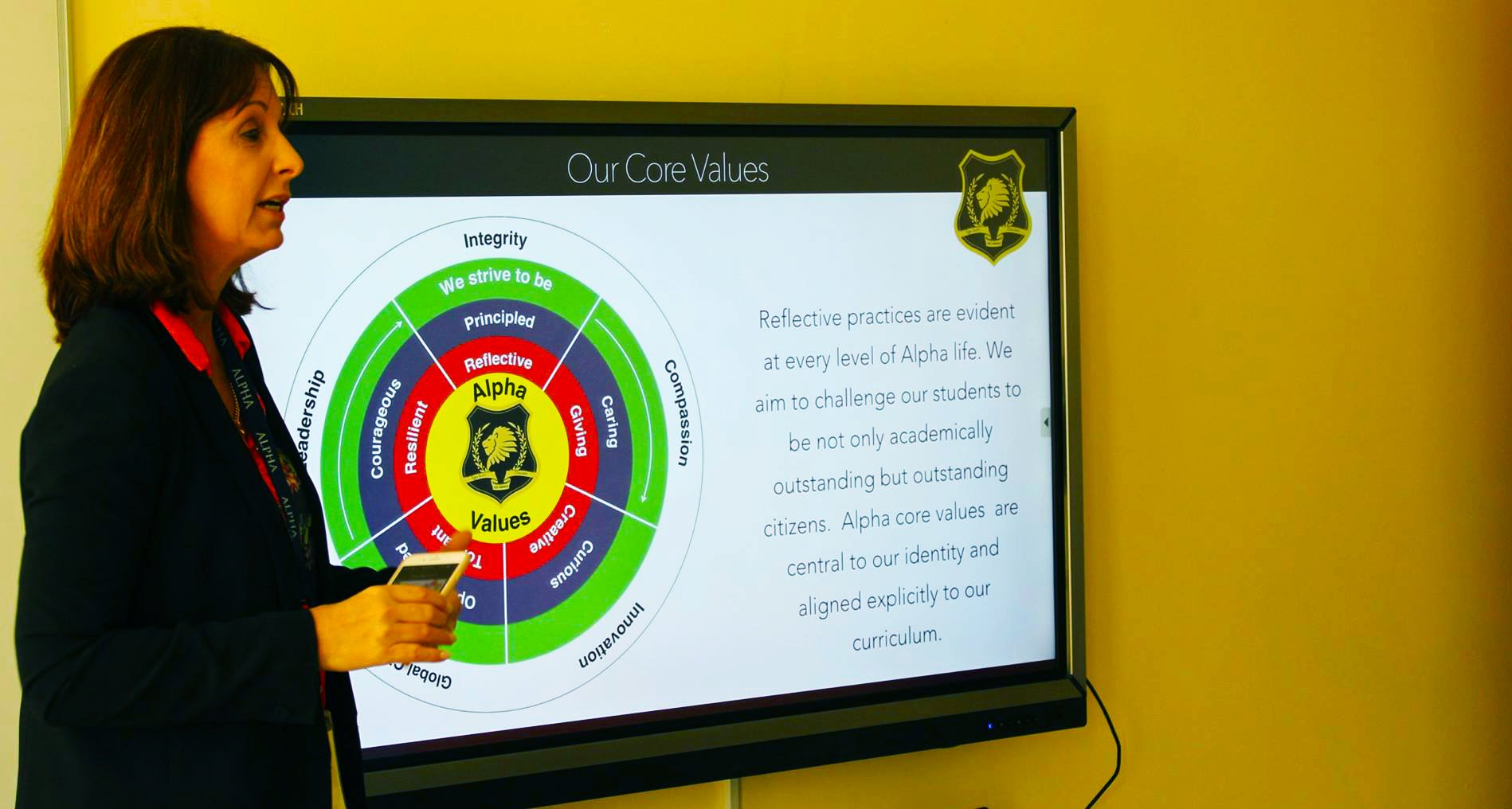 School Principal at the Alpha School in Dubai dicussing the school's values and approach with parents
