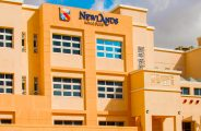A photograph of Newlands School in Dubai showcasing the low rise buildings and Arabic inspired modern architecture
