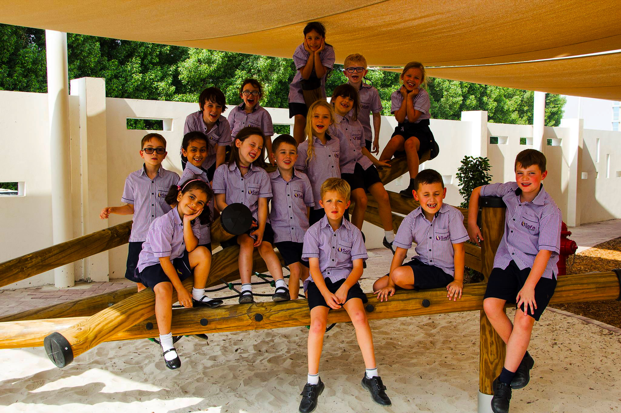 Children at Safa Community School in Dubai celebrating their end of year in one of the many shaded areas within the school's gardens