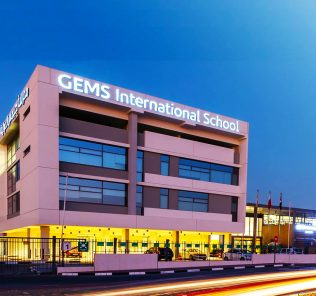 Photograph of the GEMS International School Al Khail at night