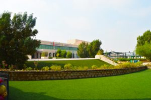 Photograph of Mirdif American School in Dubai showcasing its well kept grounds and attractive place making