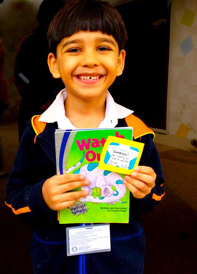 A child at the Ambassador Kindergarten in Dubai celebrating his achievements in reading