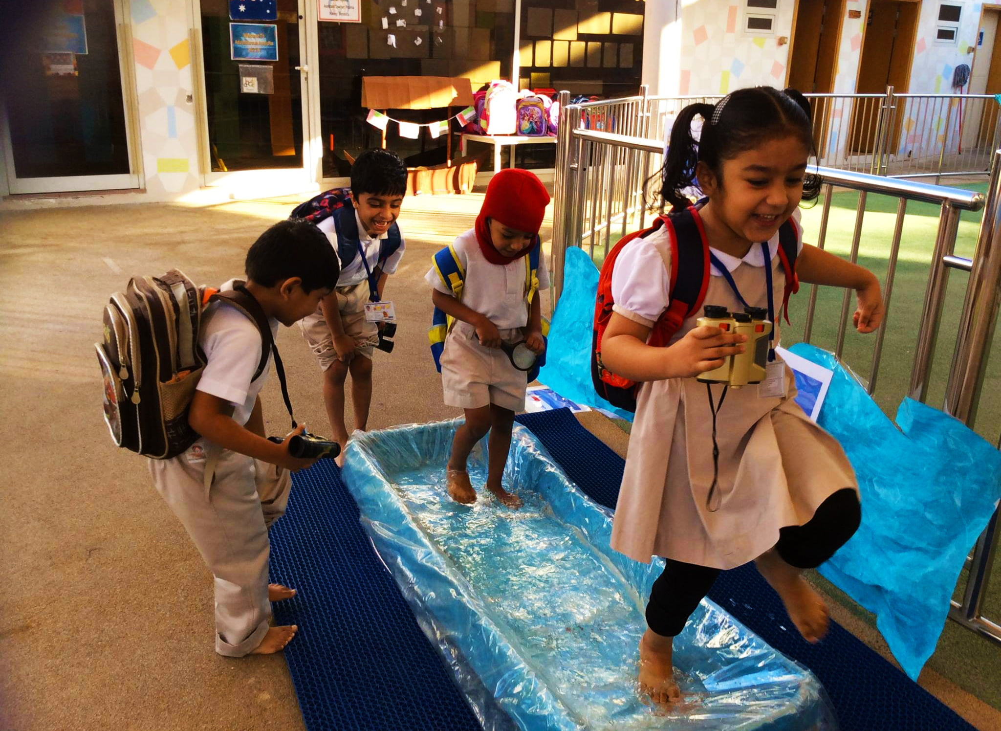 Children at the Ambassador Kindergarten in Dubai learning through water play