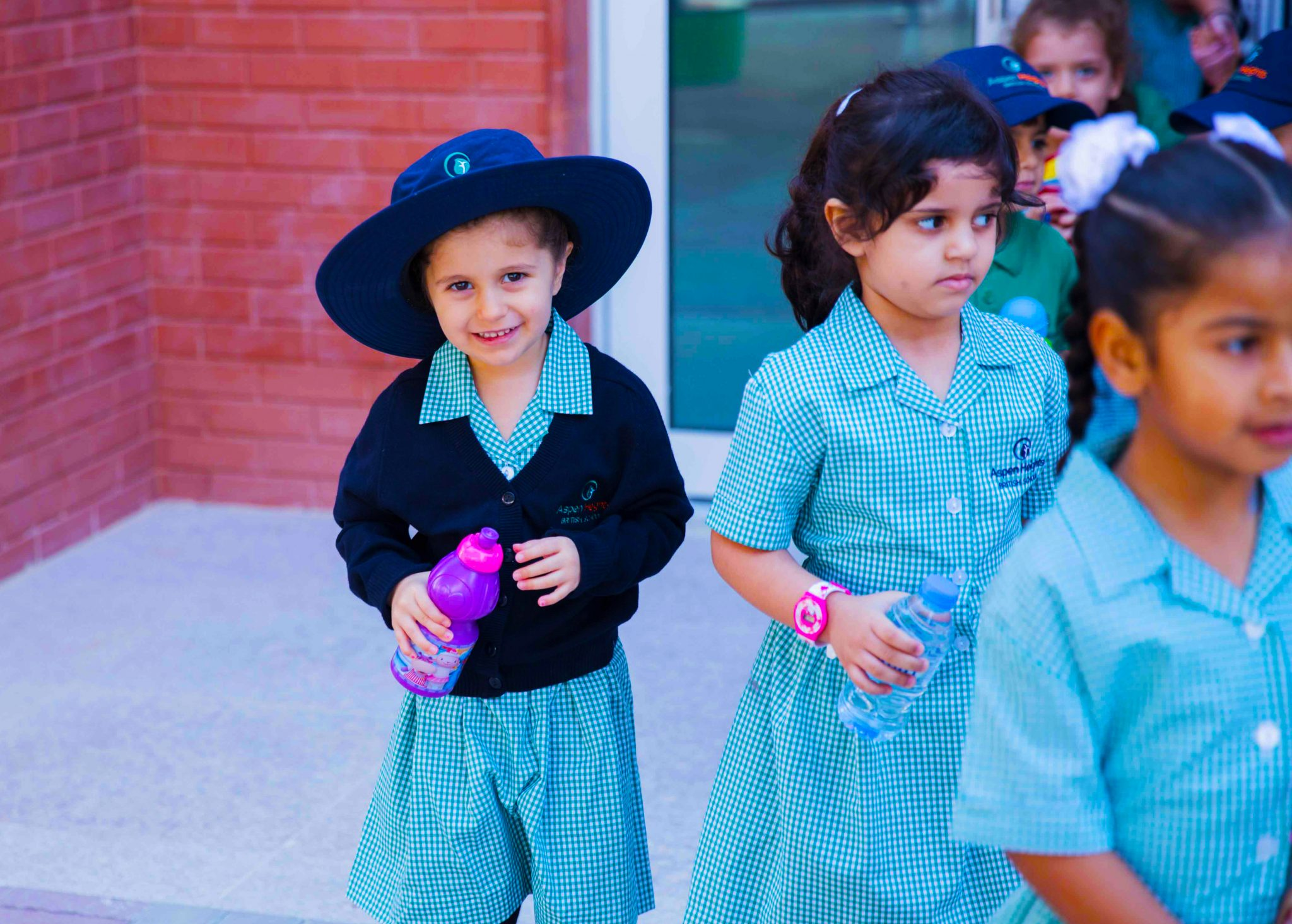 Photograph of children at the end of the school day leaving Aspen Heights British School in Abu Dhabi