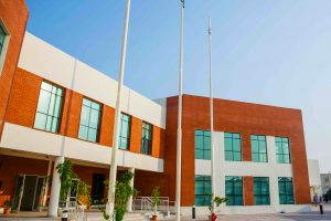 Photograph of the main school buildings and entrance to Aspen Heights British School in Abu Dhabi