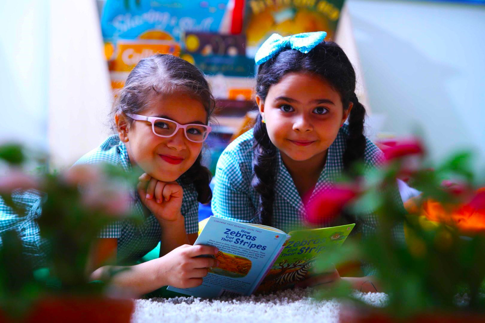 Photograph of happy younger children reading at Aspen Heights British School in Abu Dhabi