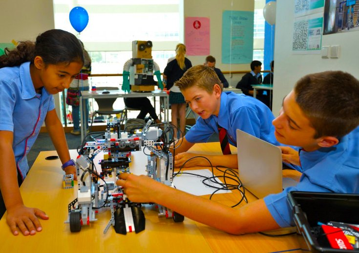 Image of children using LEGO Robotics to showcase the focus on technology at GEMS School of Digital Futures opening in Dubai in September 2018