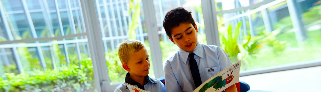 Children at Kings' School Nad Al Sheba reading