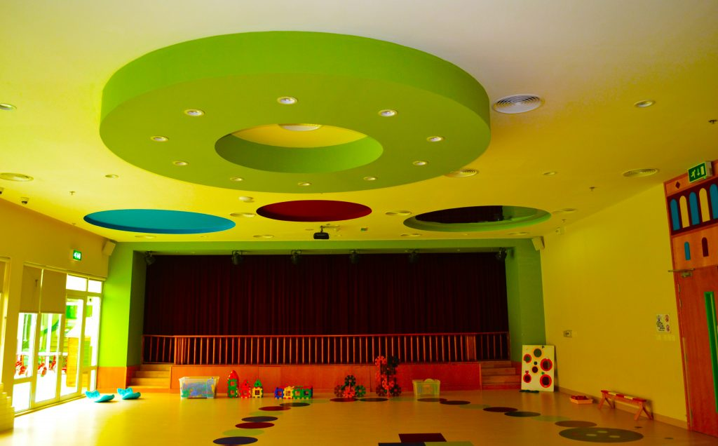 Photograph of the Theatre Auditorium at Future International Nursery Dubai showcasing the stage and extensive AV facilities