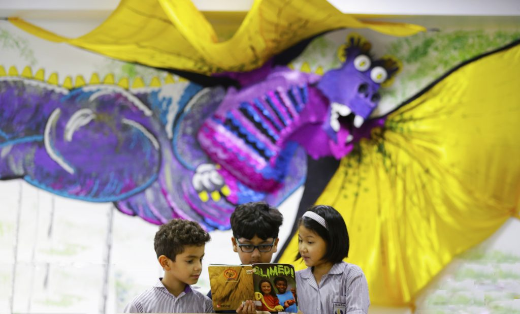 A photograph of the three dimensional dragon created by children for the Safa British School library brining wonder to the magic of children and lighting up the room