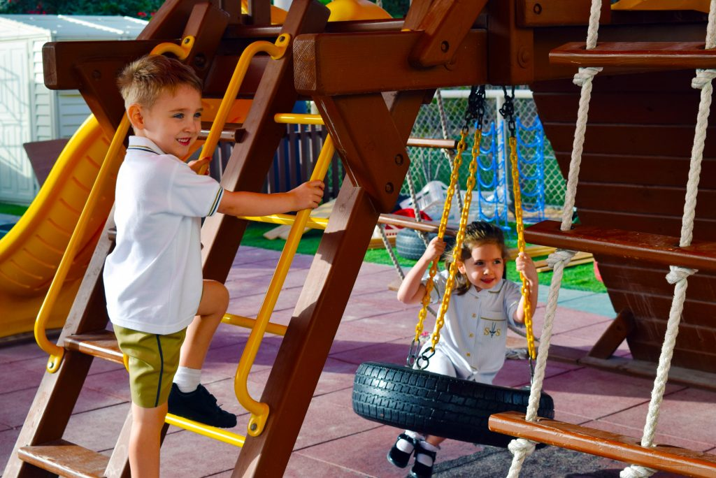 Picture of children playing at South View school in Dubai on specialist outdoor climbing frame facilities for younger children