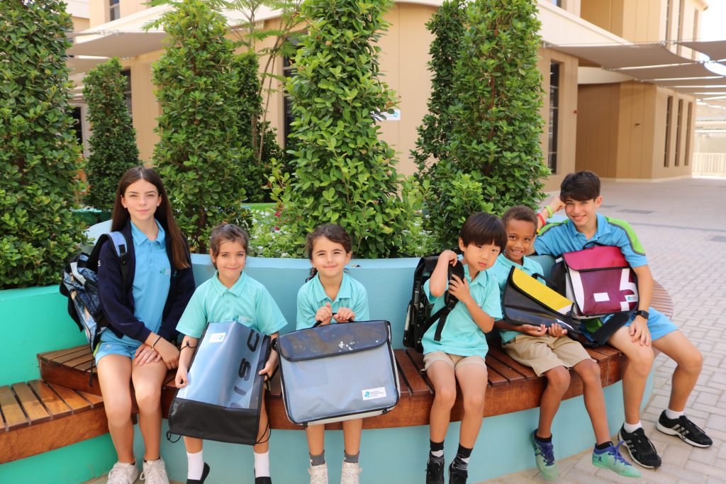 Photograph of students with biodegradable bags at Fairgreen International School in Dubai