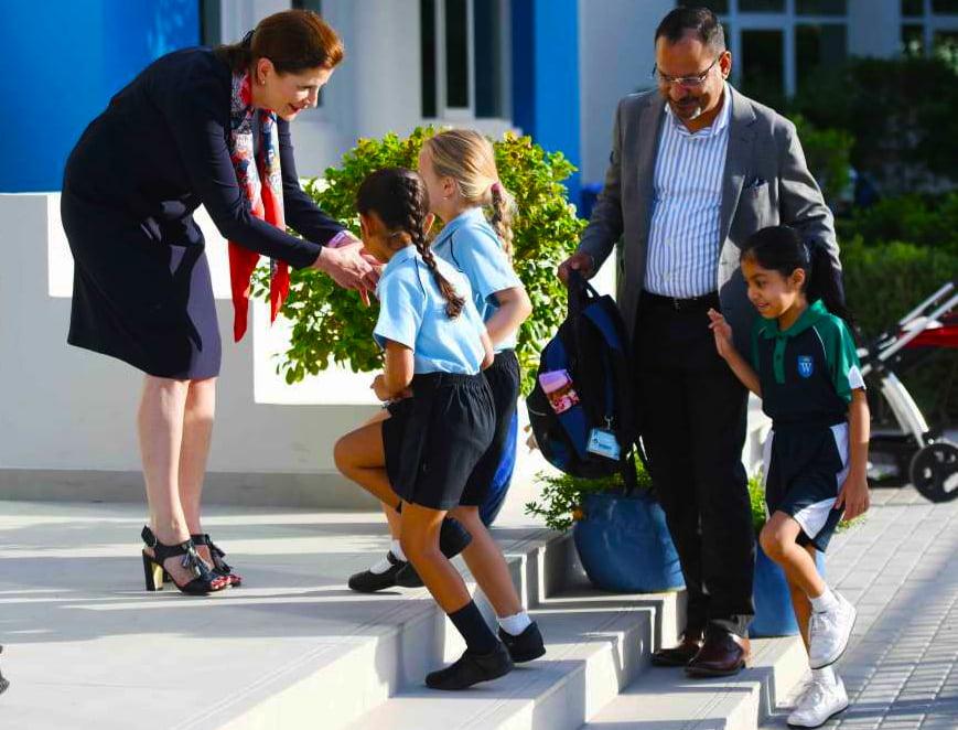 Catherine McKeever, Principa of GEMS Wellington Primary School, welcoming children