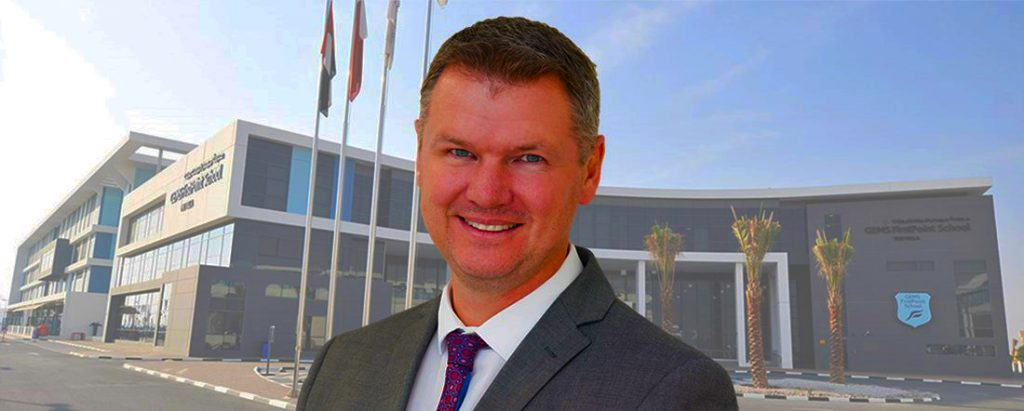 Photograph of Matthew Tompkins, Principal, GEMS FirstPoint School in Dubai outside the school.