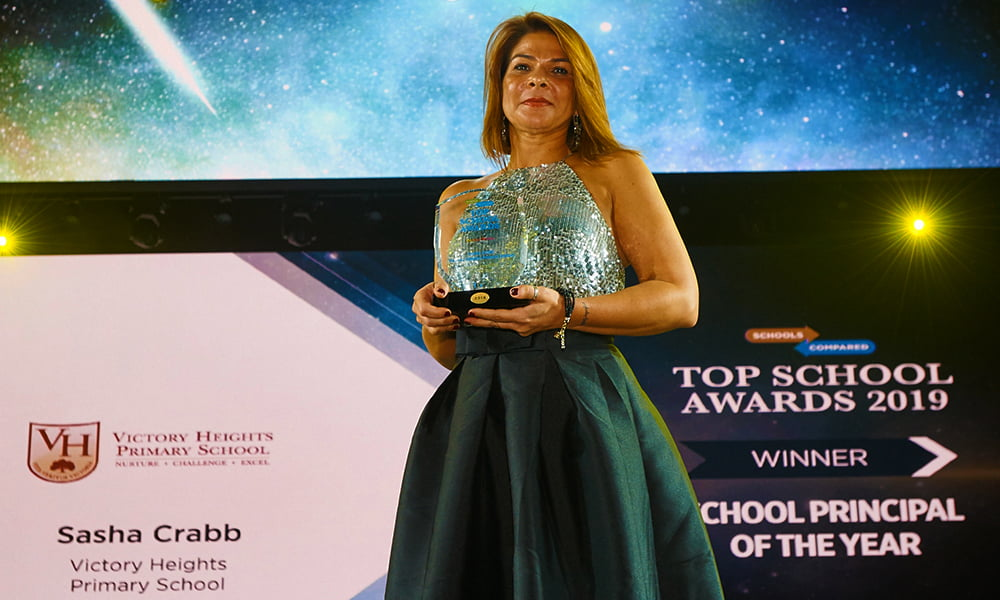 Photograph of Sasha Crabb at the SchoolsCompared Top School Awards held at the Raj Mahal Theatre in Dubai accepting her Award for the 2019 and 20 Best Principal in the UAE.