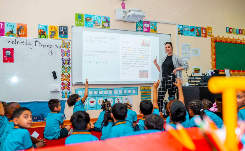 Photographs of children learning at Capital School in Dubai.