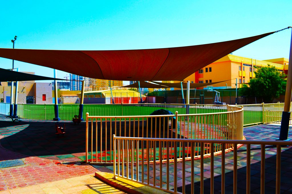 Photograph of the FS play ground at capital School Dubai with a vista ono the sports fields and Dubai skyline