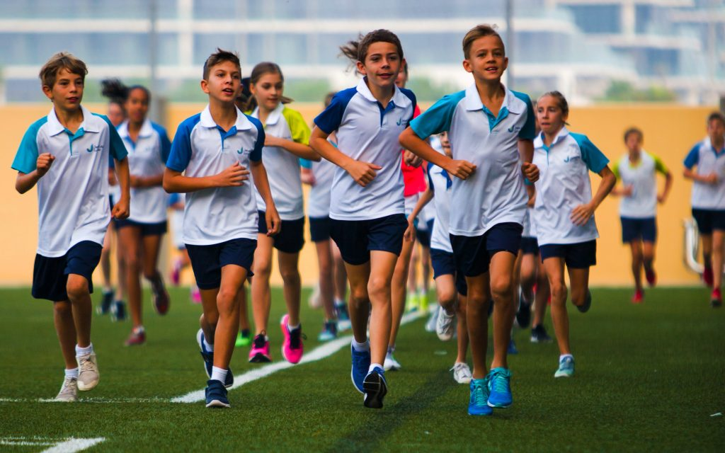 Sport at the Jebel Ali School in Dubai. Here children are seen running across the extensive school grounds set aside for spot at the school. .