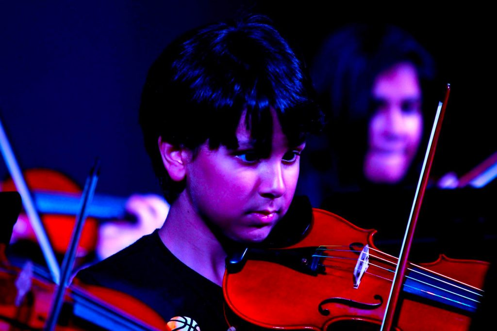 Student at Jebel Ali School in Dubai playing the violin at one of the school's many performances.