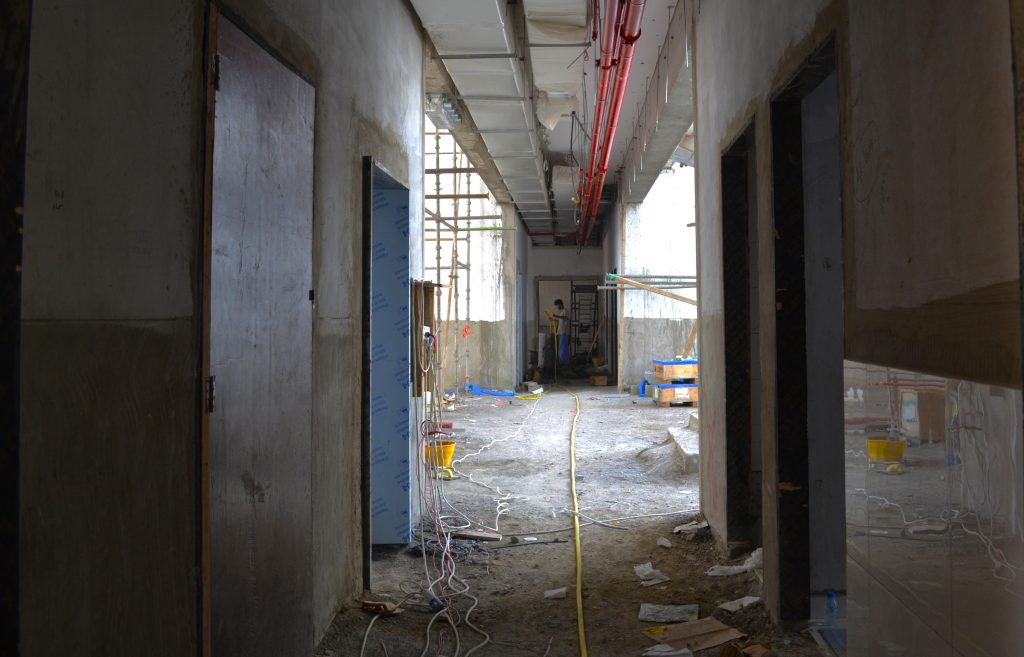 Photograph of the interior tiling at the Cedar School in Dubai as first fix electrics and internet cabling are completed
