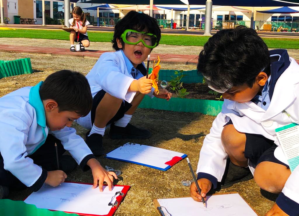 Primary children engaged in Science experiments outside at Smart Vision School in Dubai