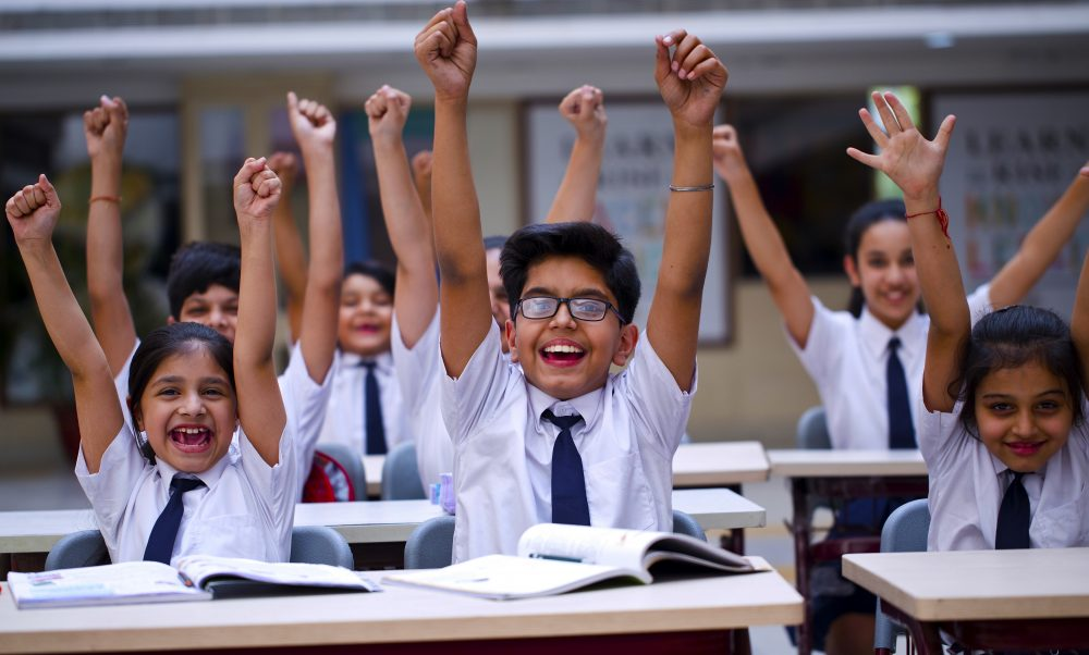 Children in Dubai celebrating after the KHDA releases school results and ratings in 2020