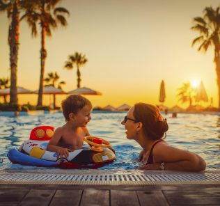 Photograph of Mum and child on holiday - not every activity has to cost the earth in the school holidays
