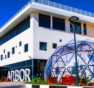 Photograph of the extraordinary frontage to the Arbor School in Dubai showcasing one of the cutting edge biodomes that lie at the heart of the education of its students.
