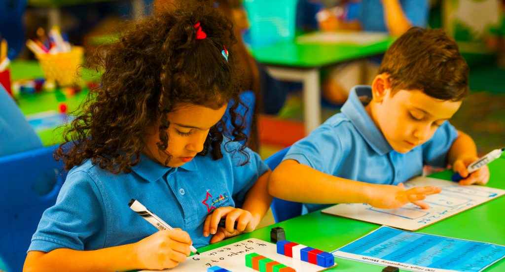 Children independently learning Mathematics at EYFS in Star International School Mirdif, a British, English national Curriculum all-through school in Dubai.