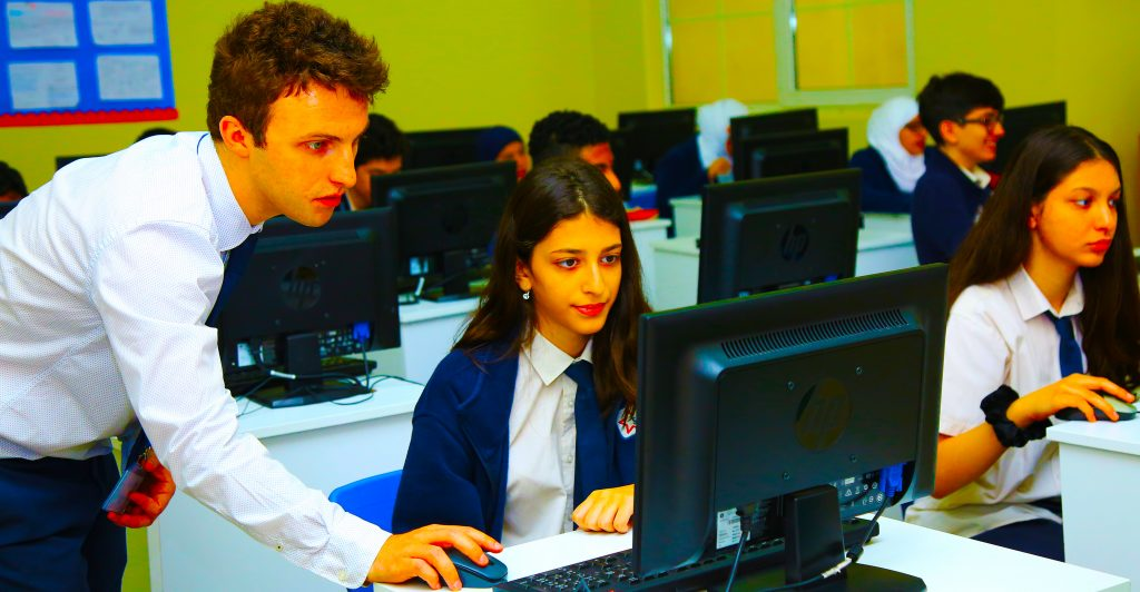 Photograph of students in an ICT Technology and Computing lesson as part of IGCSE and BTEC study at the British curriculum Star International School in Al Twar Dubai