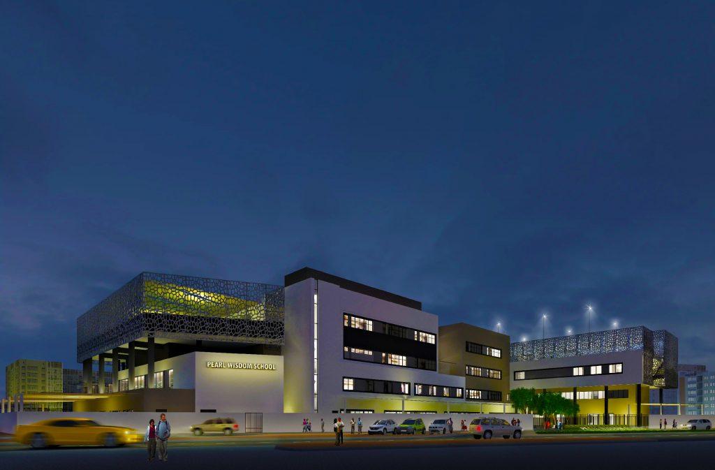 مدرسة لؤلؤة الحكمة في دبي تظهر ليلاً مع نقش شبكي مستوحى من اللغة العربية. تهدف مدرسة CBSE إلى التحمل بجودة تصميمها وهندستها المعمارية.