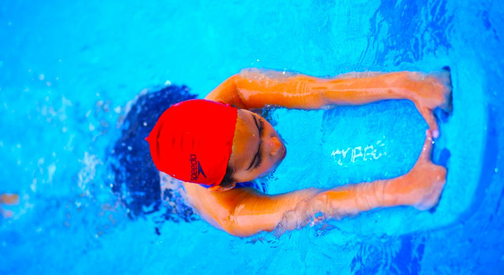 Photograph of student swimming at Star International School Al Twar in Dubai highlighting investment in Sport provision and facilities at the school