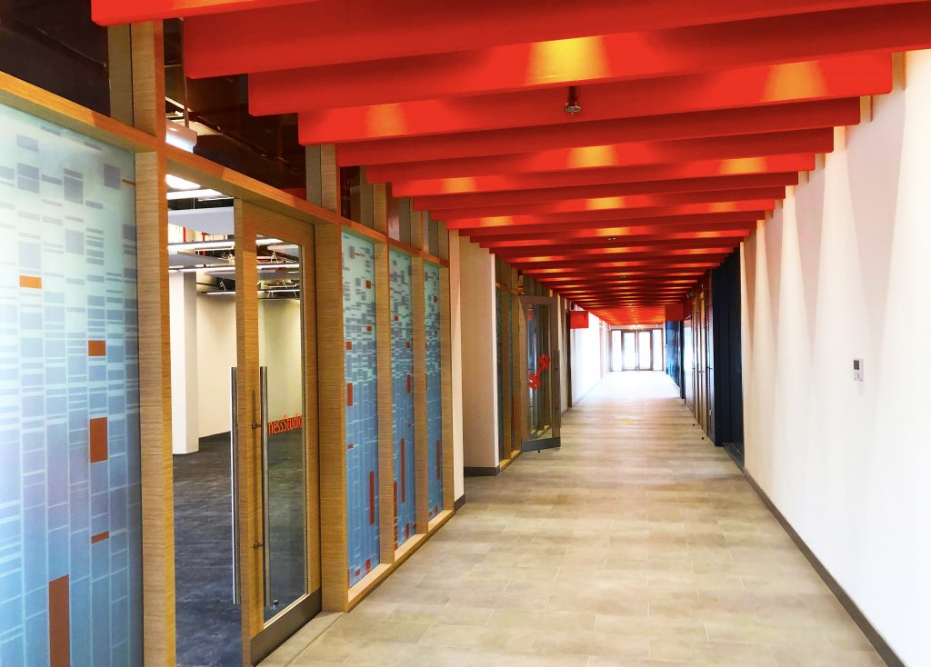 Design flair and colour has been used to create inspirational place around every corner within the new English College Dubai buildings. Here we see flashes of red light one of the wide school corridors creating the perception of a time tunnel to the future.