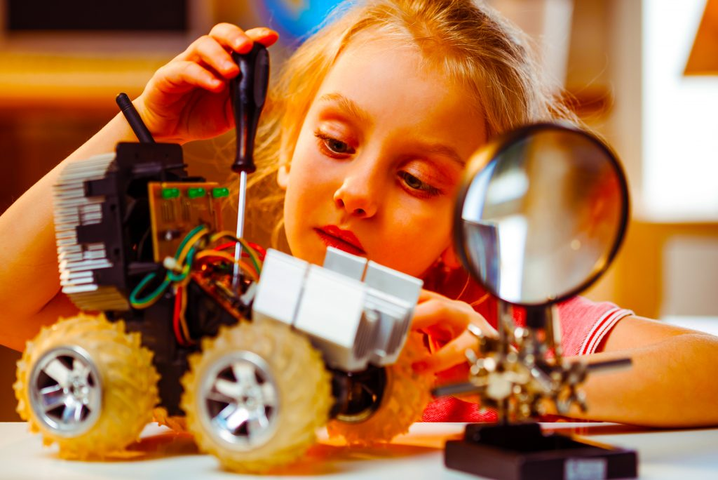 Will the future of Schools mean increasing use of robots in the classroom? Here a young girl builds a robot as the world discusses children being taught by them.