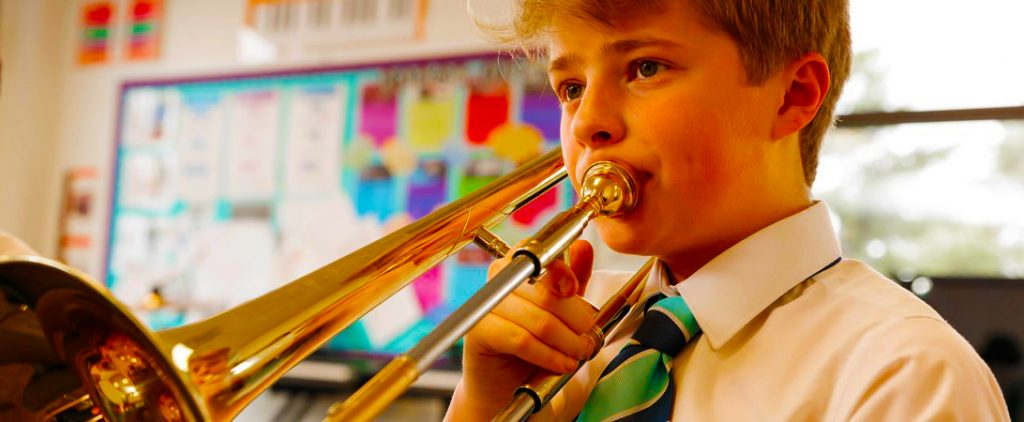 Child playing the trombone at Nord Anglia International School in Dubai. Nord Anglia won the Award for Best School for Music at the annual Top School Awards in Dubai for 2020