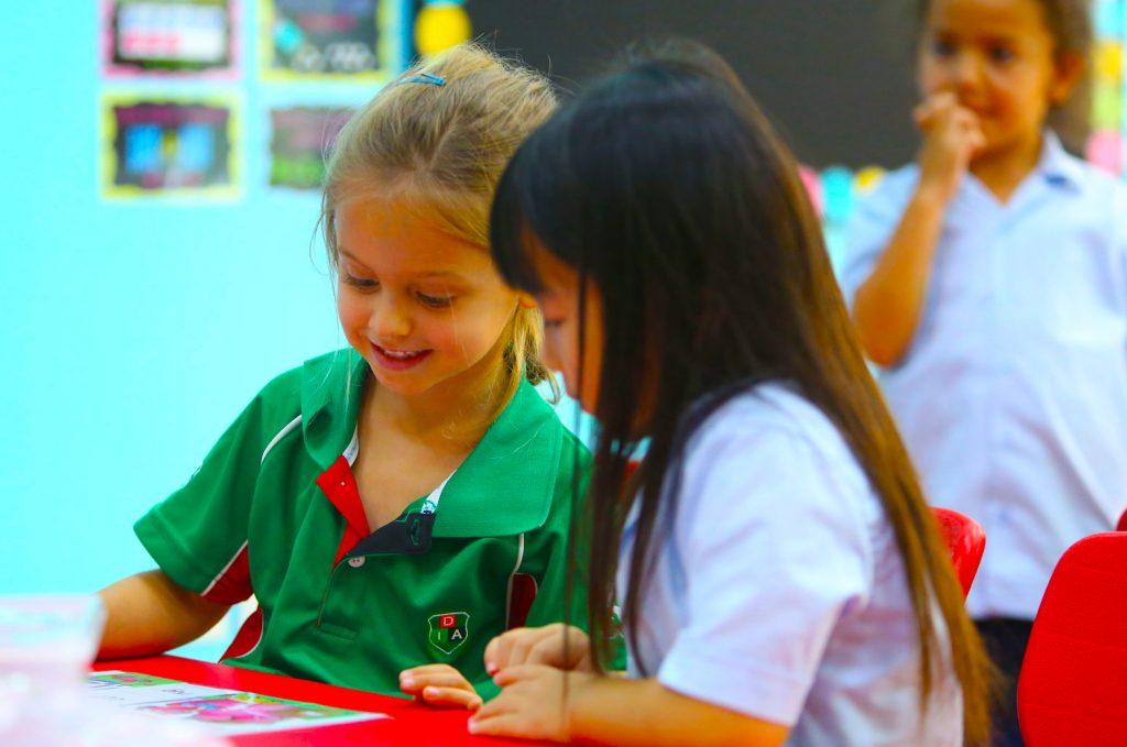 International Baccalaureate Primary Years Programme Children at Dubai International Academy Al Barsha reading in class
