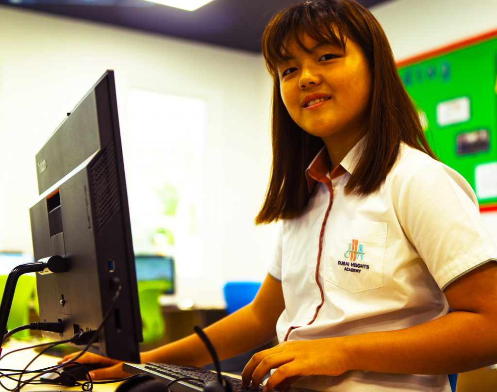Photograph of a student engaged in an ICT lesson at Dubai Heights Academy school in Dubai.